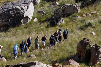 Children from the Gereformeerde Laerskool, grade 6 and 7, learning to track a leopard