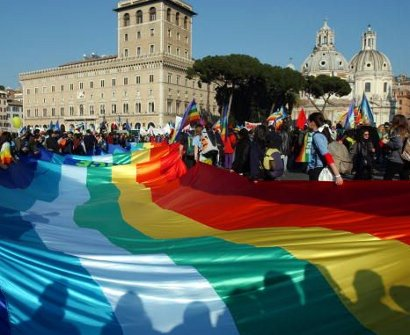 Peace demonstrators hold a rainbow peace flag in Venezia Square, Rome, 15 Feb 2003.: One million ordinary people gathered to protest the US led war on Iraq.