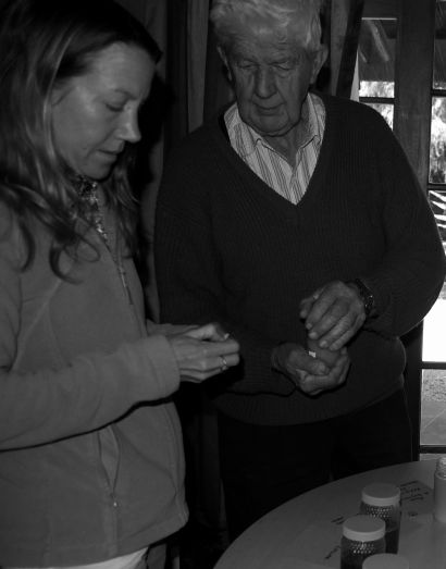 Peter Clarke demonstrating different types of honey
