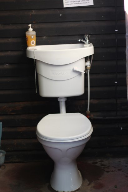 Wild Spirit Lodge: This awesome eco-toilet was apparently purchased at Penny Pinchers! (photograph by Julan Briant)