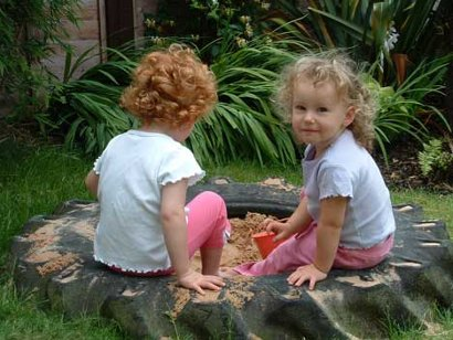 a sandpit made from an old tractor tyre
